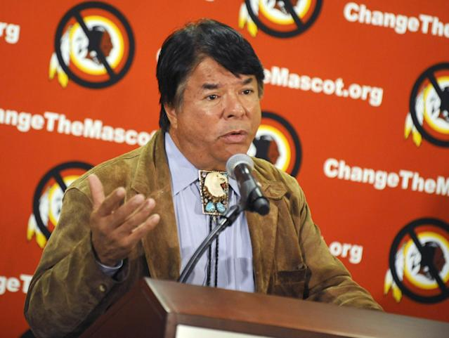 """Oneida Indian Nation representative Ray Halbritter speaks during a news conference, Wednesday, Oct. 30, 2013, in New York. Representatives of the Oneida have requested a meeting with all 32 NFL owners during Super Bowl week, hoping to persuade them to get the Washington franchise to drop the nickname Redskins. The Oneidas also asked for an amendment to league bylaws to prohibit franchises from naming a team with any term that is a racial epithet. Halbritter says the dictionary defines the word """"redskins"""" precisely like that. (AP Photo/Louis Lanzano)"""