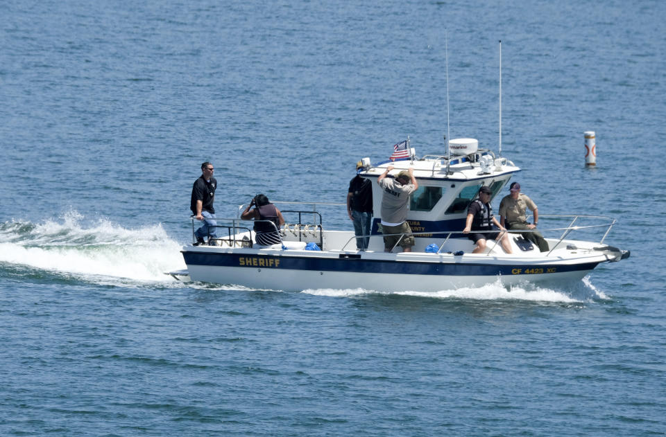 """Pictured is Members of Ventura County Sheriff's Office Underwater Search and Rescue Team search for former """"Glee"""" actress Naya Rivera on July 19"""