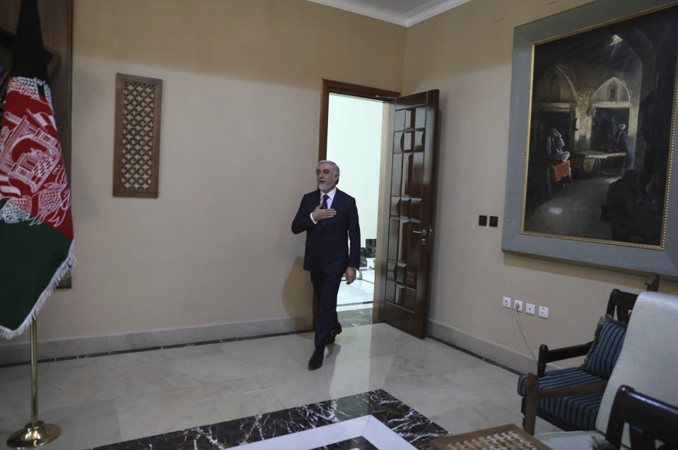 Abdullah Abdullah, Chairman of the High Council for National Reconciliation arrives for an interview to The Associated Press at the Sapidar Palace in Kabul, Afghanistan, Saturday, May 1, 2021. Afghanistan's chief peace negotiator says the often fractured Afghan political leadership must unify or risk the withdrawal of U.S. and NATO troops that has officially begun bringing more bitter fighting. (AP Photo/Rahmat Gul)