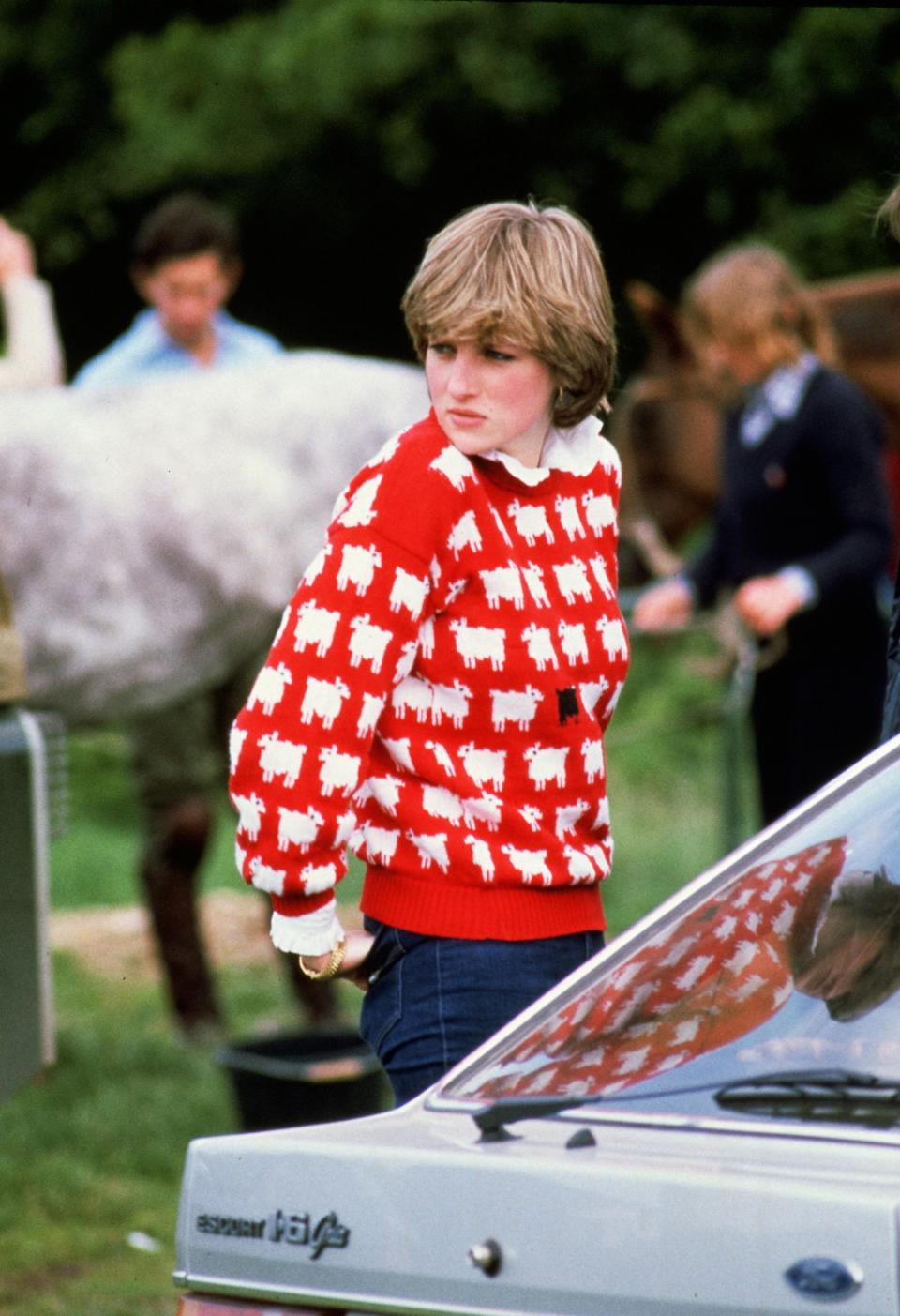 Diana, Princess of Wales wearing 'Black sheep' wool jumper by Warm and Wonderful and pie-crust shirt to Windsor Polo, June 1981. (Getty Images)