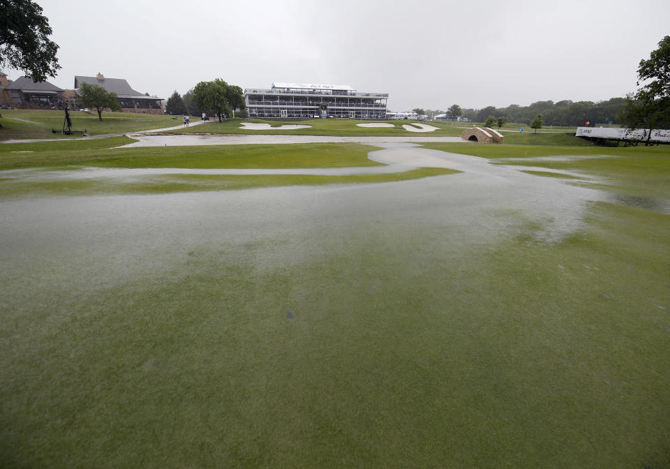 Water ponds on the 18th fairway during a weather delay of the final round of the AT&T Byron Nelson golf tournament in McKinney, Texas, Sunday, May 16, 2021. (AP Photo/Ray Carlin)