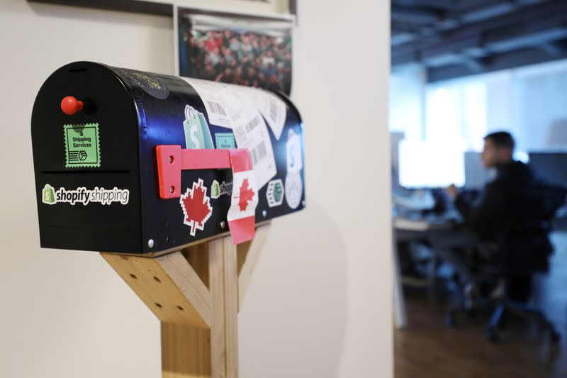 A decorative mailbox covered in stickers is seen at Shopify's headquarters in Ottawa