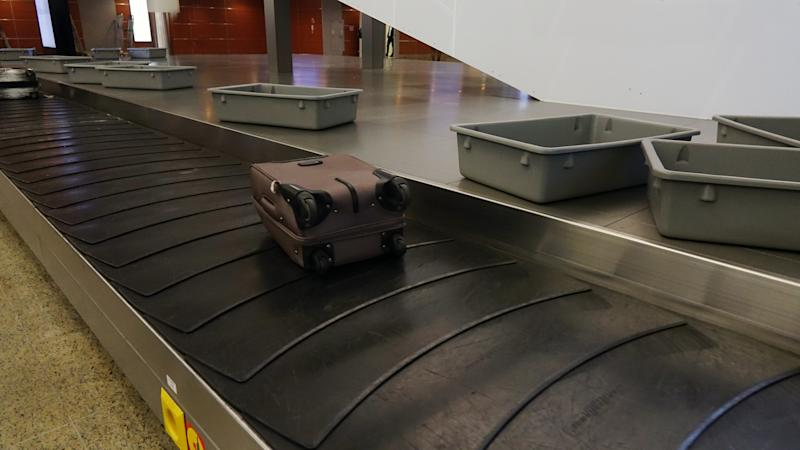 suitcases on the Luggage belt at the airport