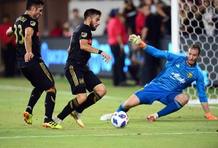 July 18, 2018; Los Angeles , CA, USA; Los Angeles FC midfielder Benny Feilhaber (33) and forward Diego Rossi (9) move in on goal against Portland Timbers goalkeeper Jeff Attinella (1) during the second half at Banc of California Stadium. Mandatory Credit: Gary A. Vasquez-USA TODAY Sports