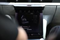 A touch screen displays a massage chair menu in a Dream Edition R at the Lucid Motors plant in Casa Grande