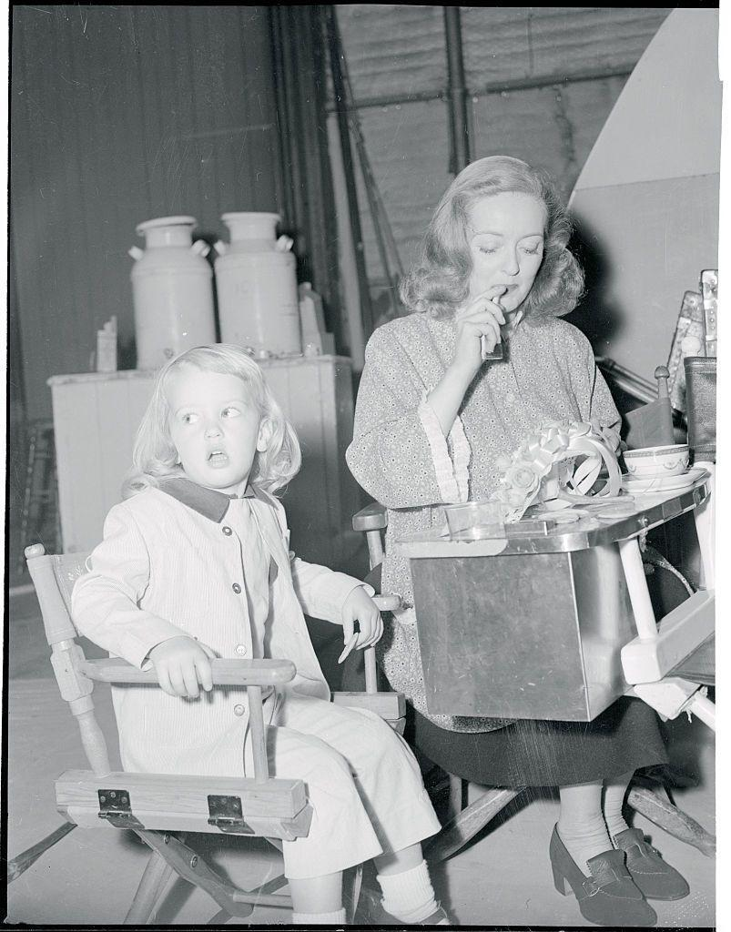 <p>Bette not only took her daughter to set in the early '50s, she put her to work. The actress's three-year-old daughter, Barbara, appeared in <em>Payment on Demand</em> with her mother in 1951.</p>