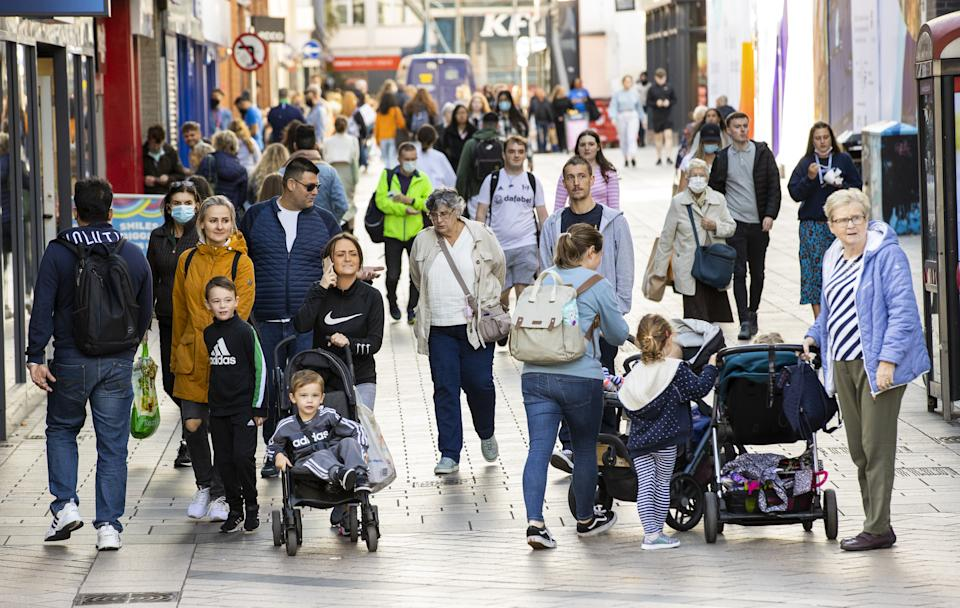 Shoppers on the high street in Belfast. The studio is offering 50% extra on top of the Northern Ireland High Street voucher scheme, when using it to purchase a Skinworks voucher. Picture date: Monday September 27, 2021.