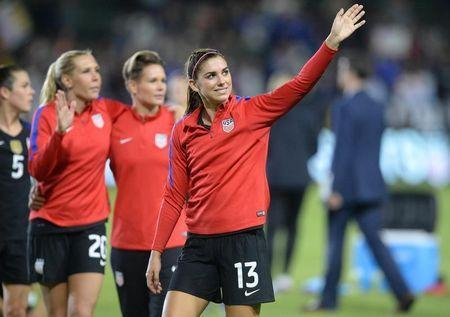 November 13, 2016; Carson, CA, USA; USA forward Alex Morgan (13) reacts following the 5-0 victory against Romania at StubHub Center. Mandatory Credit: Gary A. Vasquez-USA TODAY Sports
