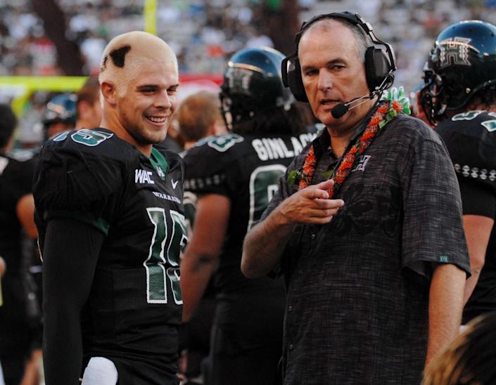 Hawaii quarterback Colt Brennan, left, and coach June Jones talk during a game against Northern Colorado on Sept. 1, 2007.