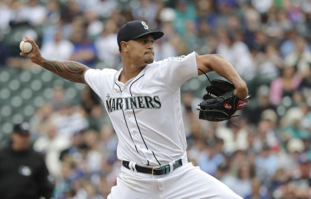 Seattle Mariners opening pitcher Sam Tuivailala throws against the Tampa Bay Rays during the first inning of a baseball game, Sunday, Aug. 11, 2019, in Seattle. (AP Photo/Ted S. Warren)
