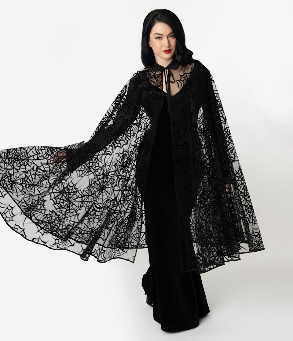 <p>Look as sinister as can be in this <span>Unique Vintage Black Mesh and Velvet Spiderweb Clarke Long Cape</span> ($78). </p>
