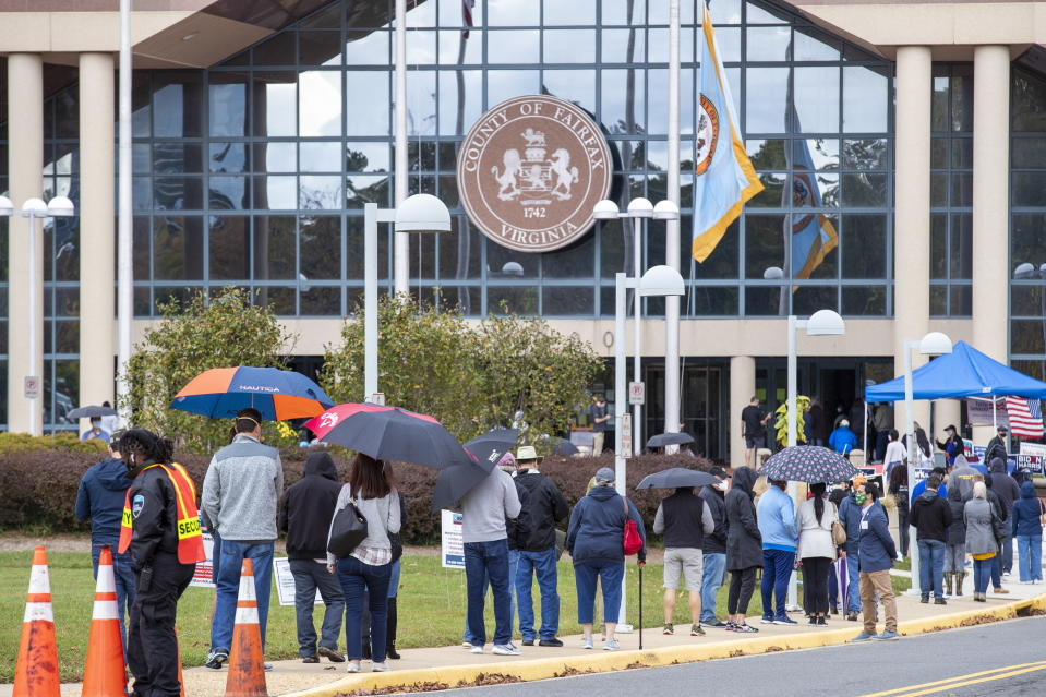 Voters line up to cast their ballots for the 2020 presidential election at the Fairfax County Government Center in Fairfax, Virginia. Source: EPA
