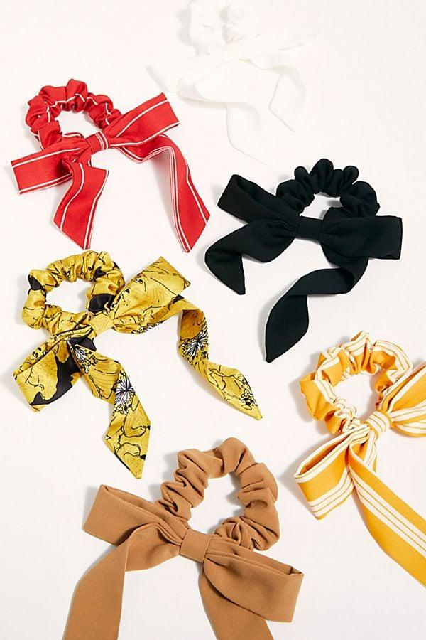 """<p>Get her a few of these <a href=""""https://www.popsugar.com/buy/Bow-Scrunchies-542435?p_name=%20Bow%20Scrunchies&retailer=freepeople.com&pid=542435&price=6&evar1=savvy%3Auk&evar9=45680954&evar98=https%3A%2F%2Fwww.popsugar.com%2Fsmart-living%2Fphoto-gallery%2F45680954%2Fimage%2F47132802%2FBow-Scrunchie&list1=shopping%2Cvalentines%20day%2Cgifts%20for%20women&prop13=api&pdata=1"""" rel=""""nofollow"""" data-shoppable-link=""""1"""" target=""""_blank"""" class=""""ga-track"""" data-ga-category=""""Related"""" data-ga-label=""""https://www.freepeople.com/shop/bow-scrunchie/?category=all-valentines-day-gifts&amp;color=023"""" data-ga-action=""""In-Line Links""""> Bow Scrunchies </a> ($6) in her favorite color.</p>"""