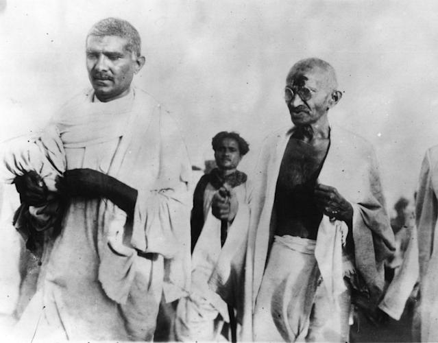 31st March 1930: Pacifist and Indian nationalist leader Mahatma Gandhi (Mohandas Karamchand Gandhi, 1869 - 1948) during the Salt March protesting against the government monopoly on salt production. (Photo by Topical Press Agency/Getty Images)
