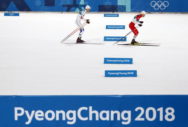 Nordic Combined Events - Pyeongchang 2018 Winter Olympics - Men's Individual 10 km Final - Alpensia Cross-Country Skiing Centre - Pyeongchang, South Korea - February 20, 2018 - Jarl Magnus Riiber of Norway and Akito Watabe of Japan in action. REUTERS/Kai Pfaffenbach