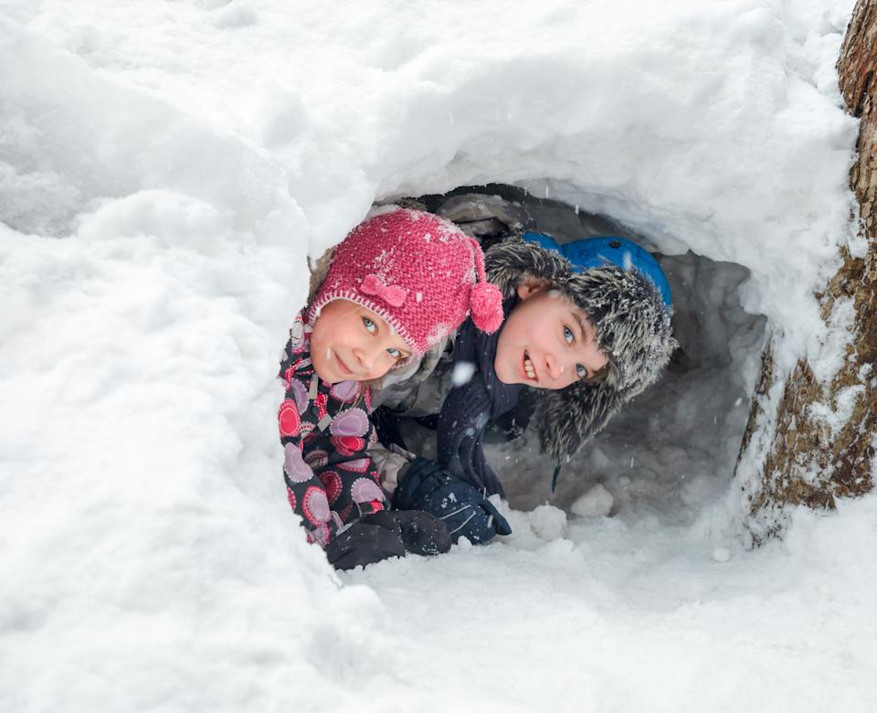 Snow forts built into embankments can collapse - and cause suffocation. Image via Getty Images.