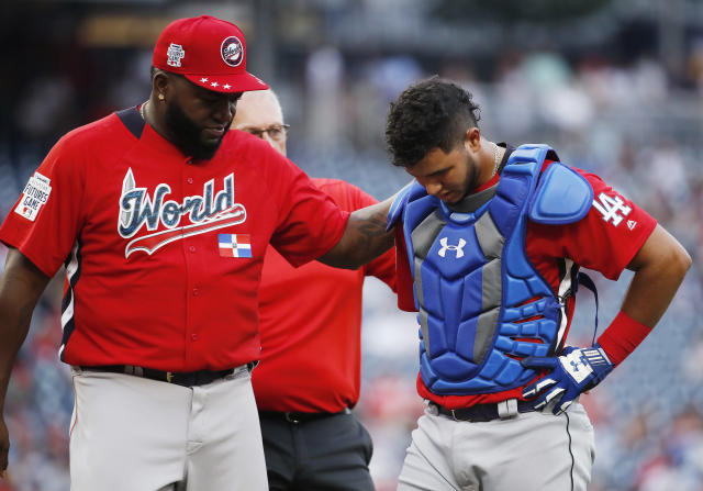 World Team manager David Ortiz, left confers with Seuly Matias in the seventh inning of the All-Star Futures baseball game against the World Team, Sunday, July 15, 2018, at Nationals Park, in Washington. The the 89th MLB baseball All-Star Game will be played Tuesday. (AP Photo/Alex Brandon)