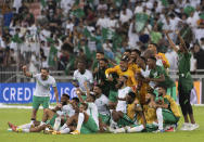 Saudi Arabia's players celebrate after they defeated Japan 1-0 in the Asian zone group B qualifying soccer match for the FIFA World Cup Qatar 2022 at the King Abdullah sports city stadium, in Jiddah, Saudi Arabia, Thursday, Oct. 7, 2021. (AP Photo)