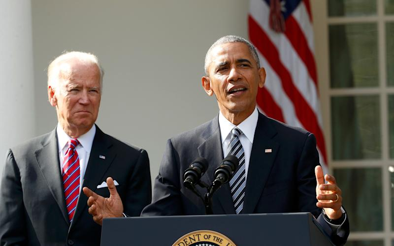 Joe Biden, left, and Barack Obama - REUTERS/Kevin Lamarque