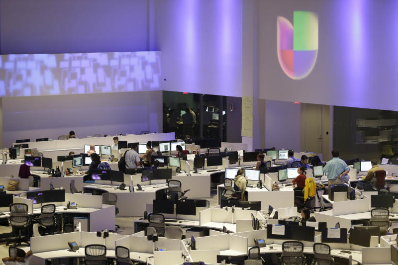 In this Tuesday, Aug. 20, 2013 photo, a large newsroom for the Fusion TV network, a joint venture between Univision and ABC that will cater to young English-speaking Latinos is shown in Miami. The network's mix of news, commentary, sports and irreverence is aimed at 16 to 30-year-olds, a demographic for which cultural fusion is the norm and digital media is king. (AP Photo/Wilfredo Lee)