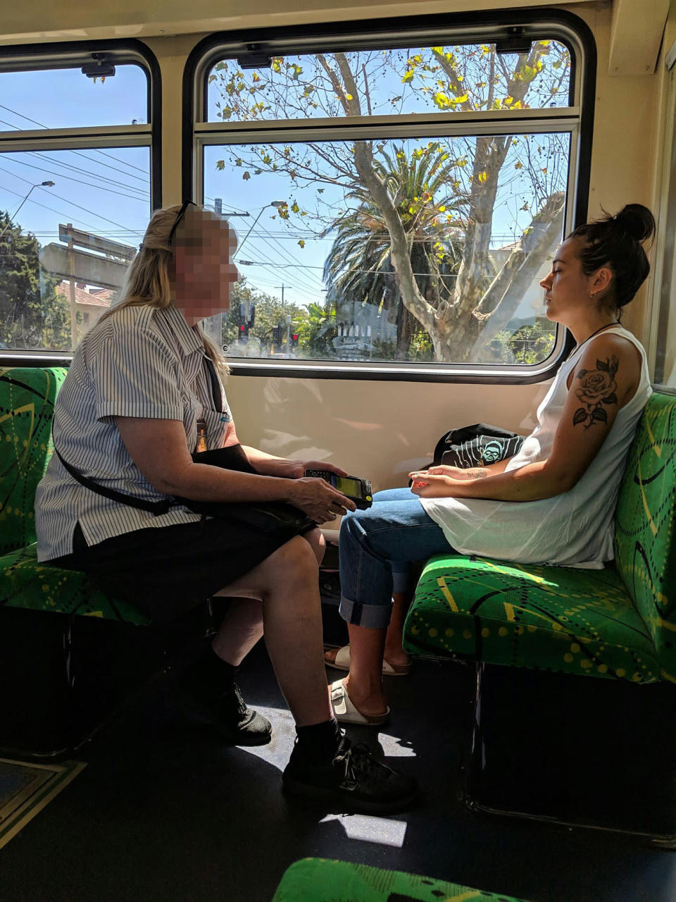 Highly amused commuters watched on as the ticket inspector tried to get Steph Athanasopoulos' attention. Source: Supplied