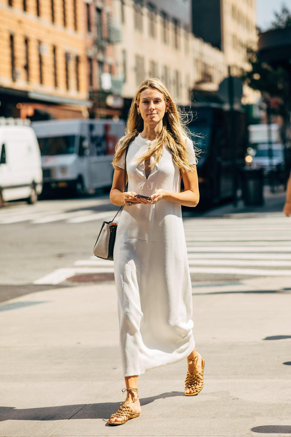 <p>Play it cool in a simple sheath and sandals.</p>