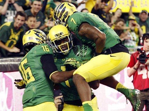 Oregon Receiver Josh Huff, middle, celebrates his touchdown with teammates Daryle Hawkins, left, and Keanon Lowe during the first half of their NCAA college football game against Arkansas State in Eugene, Ore., Saturday, Sept. 1, 2012. (AP Photo/Don Ryan)