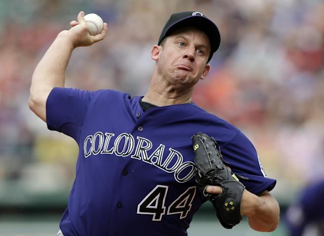 In this June 26, 2013, photo, Colorado Rockies starting pitcher Roy Oswalt delivers to the Boston Red Sox during the first inning of a baseball game at Fenway Park in Boston. Oswalt is retiring after 13 major league seasons.Oswalt's agent, Bob Garber, confirmed Oswalt's retirement Tuesday, Feb. 11, 2014, and said the pitcher would come to work for his agency. Oswalt, 36, had a 163-102 career record with a 3.36 ERA. His best season came with Houston in 2004, when he went 20-10 with a 3.49 ERA. (AP Photo/Elise Amendola)