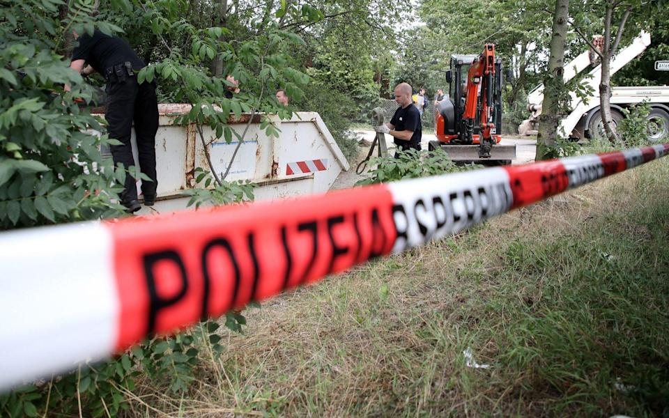 German police officers dig up and search a garden plot in Hannover, northern Germany, as part of the investigation into Madeleine McCann's disappearance - Friedemann Vogel/EPA-EFE/Shutterstock