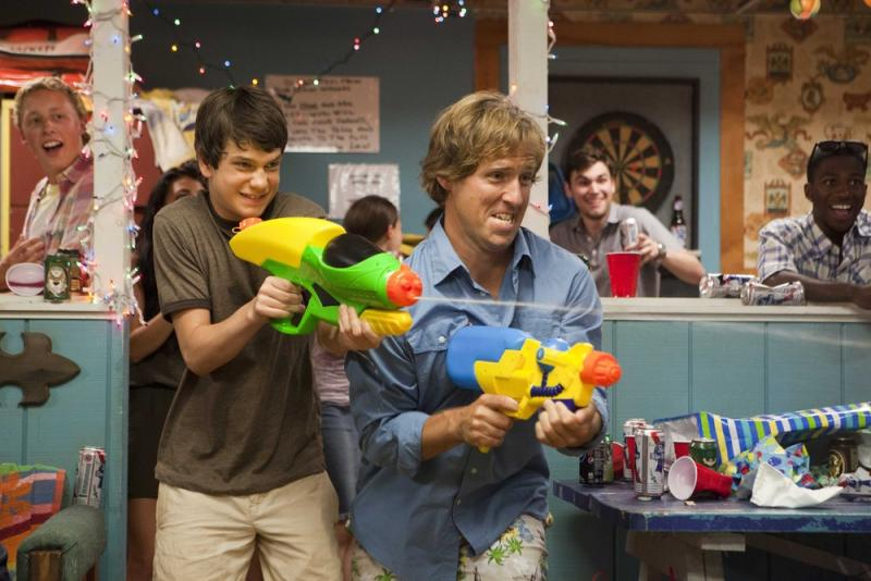 """This film publicity image released by Fox Searchlight shows Liam James, left, and Nat Faxon in a scene from """"The Way Way Back."""" (AP Photo/Fox Searchlight, Claire Folger)"""