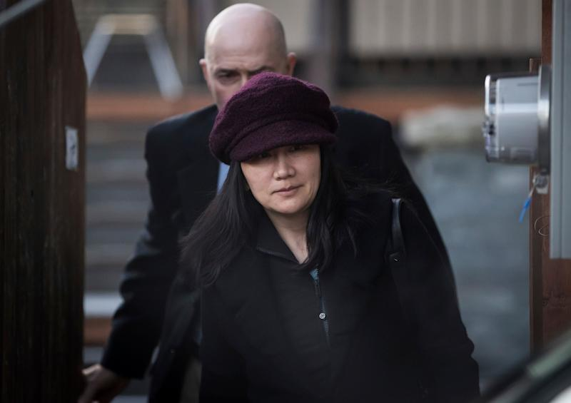 Huawei chief financial officer Meng Wanzhou, who is out on bail and remains under partial house arrest after she was detained Dec. 1 at the behest of American authorities, leaves her home to attend a court appearance regarding her bail conditions, in Vancouver, British Columbia, Tuesday Jan. 29, 2019. (Darryl Dyck/The Canadian Press via AP)