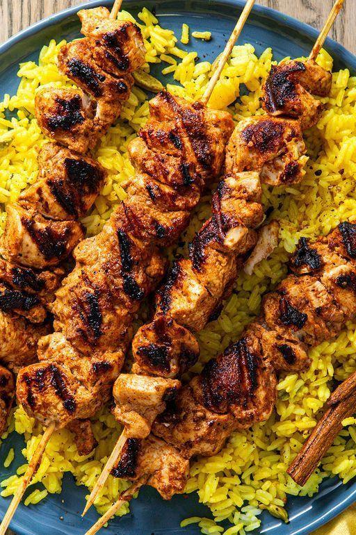 """<p>Chicken tikka is great if you're looking for a new Indian dish to perfect at home. The traditional dish consists of small pieces of marinated chicken, threaded onto skewers and grilled. </p><p>Get the <a href=""""https://www.delish.com/uk/cooking/recipes/a30622260/chicken-tikka/"""" rel=""""nofollow noopener"""" target=""""_blank"""" data-ylk=""""slk:Chicken Tikka"""" class=""""link rapid-noclick-resp"""">Chicken Tikka</a> recipe.</p>"""