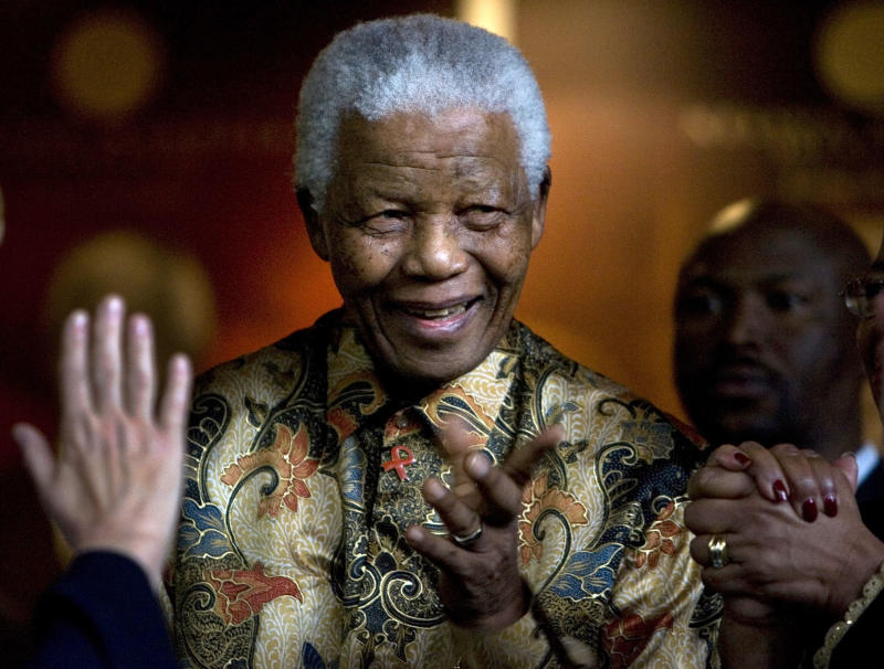 FILE - In this Oct. 6, 2007 file photo, former South African President Nelson Mandela reacts as German Chancellor Angela Merkel, left, waves farewell after a meeting at the Nelson Mandela Foundation building in Johannesburg, South Africa.  Former South African President Nelson Mandela has been hospitalized with a stomach ailment, according to a government statement issued Saturday Feb. 25, 2012 about the 93-year-old anti-apartheid icon. (AP Photo/Peter Dejong, file)