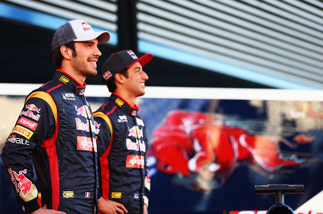 JEREZ DE LA FRONTERA, SPAIN - FEBRUARY 04:  (L-R)  Jean-Eric Vergne of France and Scuderia Toro Rosso and Daniel Ricciardo of Australia and Scuderia Toro Rosso pose during the Toro Rosso F1 STR8 Launch at Circuito de Jerez on February 4, 2013 in Jerez de la Frontera, Spain.  (Photo by Paul Gilham/Getty Images)