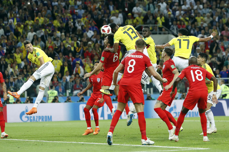 <p>Yerry Mina, center, scores his third goal of the World Cup with a towering header </p>