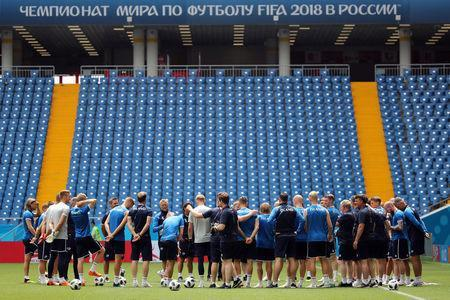 Soccer Football - World Cup - Iceland Training - Rostov Arena, Rostov-on-Don, Russia - June 25, 2018 Iceland coach Heimir Hallgrimsson with his players during training REUTERS/Marko Djurica