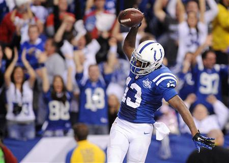 Jan 4, 2014; Indianapolis, IN, USA; Indianapolis Colts receiver T.Y. Hilton (13) celebrates after scoring the winning touchdown in the fourth quarter against the Kansas City Chiefs during the 2013 AFC wild card playoff football game at Lucas Oil Stadium. Mandatory Credit: Thomas J. Russo-USA TODAY Sports