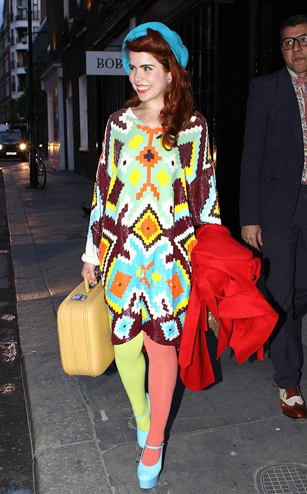 """Fellow Brit Paloma Faith recently stepped out in her own fashion faux pas, consisting of a multi-colored muumuu, mismatched stockings, platform pumps, and a horrific, electric-blue hat. Fred Duval/<a href=""""http://www.filmmagic.com/"""" target=""""new"""">FilmMagic.com</a> - May 12, 2010"""