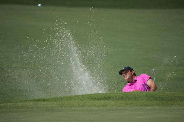 Patrick Reed of the U.S. hits from a sand trap on the second hole during final round play of the 2018 Masters golf tournament at the Augusta National Golf Club in Augusta, Georgia, U.S. April 8, 2018. REUTERS/Brian Snyder