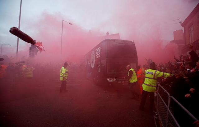 <p>Soccer Football – Champions League Quarter Final First Leg – Liverpool vs Manchester City – Anfield, Liverpool, Britain – April 4, 2018 Liverpool fans set off flares and throw missiles at the Manchester City team bus outside the stadium before the match Action Images via Reuters/Carl Recine TPX IMAGES OF THE DAY </p>