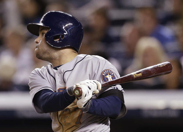 Houston Astros' Jose Altuve follows through on an hits an RBI single during the seventh inning of a baseball game against the New York Yankees Wednesday, Aug. 20, 2014, in New York. (AP Photo/Frank Franklin II)