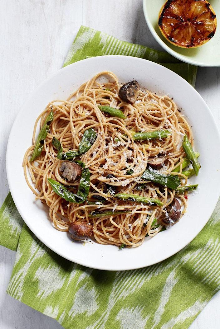"""<p>This savory vegetarian-friendly dish is full of robust cremini mushrooms and fresh green beans. And best of all? It only takes 20 minutes to prepare.</p><p><em><a href=""""https://www.womansday.com/food-recipes/food-drinks/recipes/a58984/spaghetti-grilled-green-beans-mushrooms/"""" rel=""""nofollow noopener"""" target=""""_blank"""" data-ylk=""""slk:Get the Spaghetti with Grilled Green Beans and Mushrooms recipe."""" class=""""link rapid-noclick-resp"""">Get the Spaghetti with Grilled Green Beans and Mushrooms recipe.</a></em></p>"""