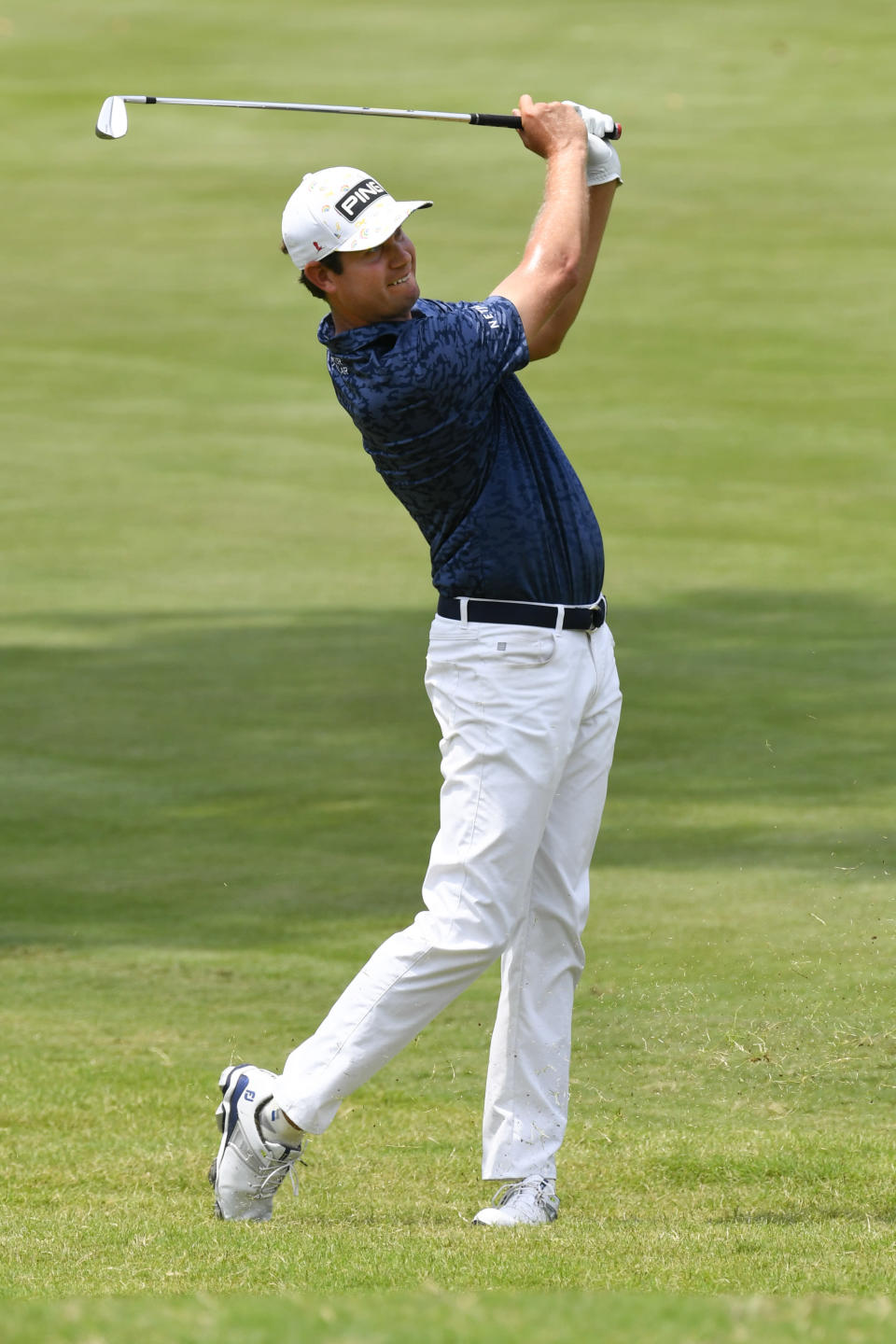 Harris English hits on 10th hole during the first round in the World Golf Championship-FedEx St. Jude Invitational tournament, Thursday, Aug. 5, 2021, in Memphis, Tenn. (AP Photo/John Amis)