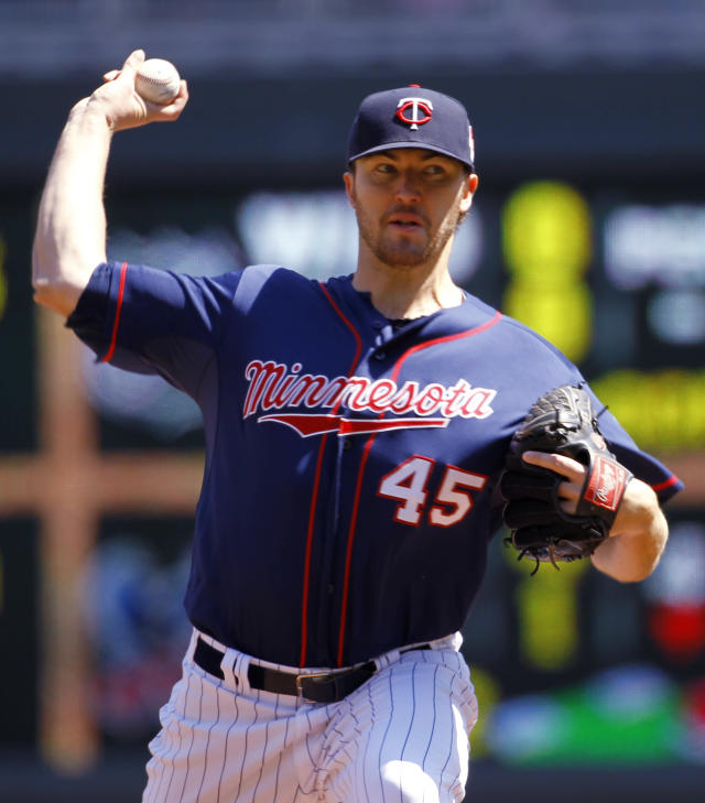 Minnesota Twins pitcher Phil Hughes delivers to the Baltimore Orioles during the third inning of a baseball game in Minneapolis, Sunday, May 4, 2014. (AP Photo/Ann Heisenfelt)