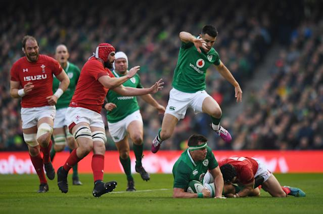 Rugby Union - Six Nations Championship - Ireland vs Wales - Aviva Stadium, Dublin, Republic of Ireland - February 24, 2018 Ireland's Conor Murray jumps over CJ Stander as Wales' Cory Hill gives chase REUTERS/Clodagh Kilcoyne