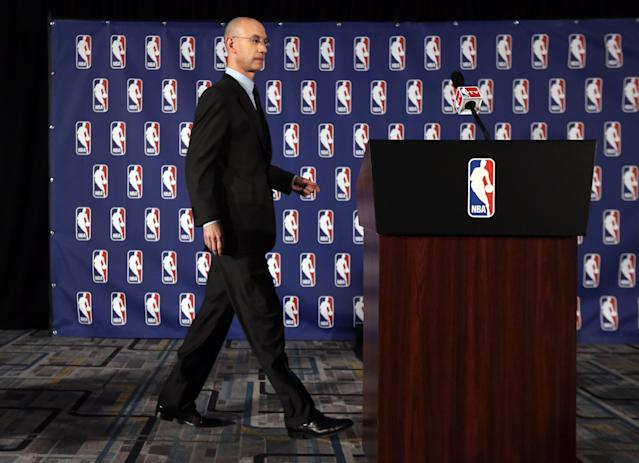 NBA Commissioner Adam Silver walks to the podium at news conference in New York, Tuesday, April 29, 2014. Silver announced that he is banning Los Angeles Clipper owner Donald Sterling for life from the Clippers organization, in response to racist comments the league says he made in an audio recording. (AP Photo/Richard Drew)