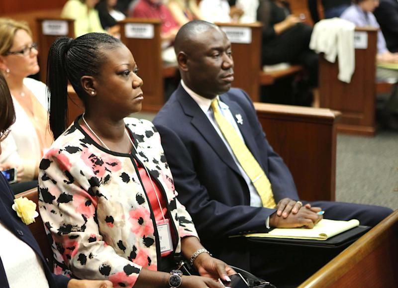 Sybrina Fulton, front left, mother of slain teen Trayvon Martin, and family attorney Benjamin Crump, watch the proceedings in the George Zimmerman trial in Seminole circuit court in Sanford, Fla., Monday, June 17, 2013. Zimmerman has been charged with second-degree murder for the 2012 shooting death of Trayvon Martin.(AP Photo/Orlando Sentinel, Joe Burbank, Pool)