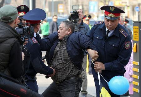 Police officers detain an anti-government protester during a rally in Almaty, Kazakhstan March 22, 2019. REUTERS/Pavel Mikheyev
