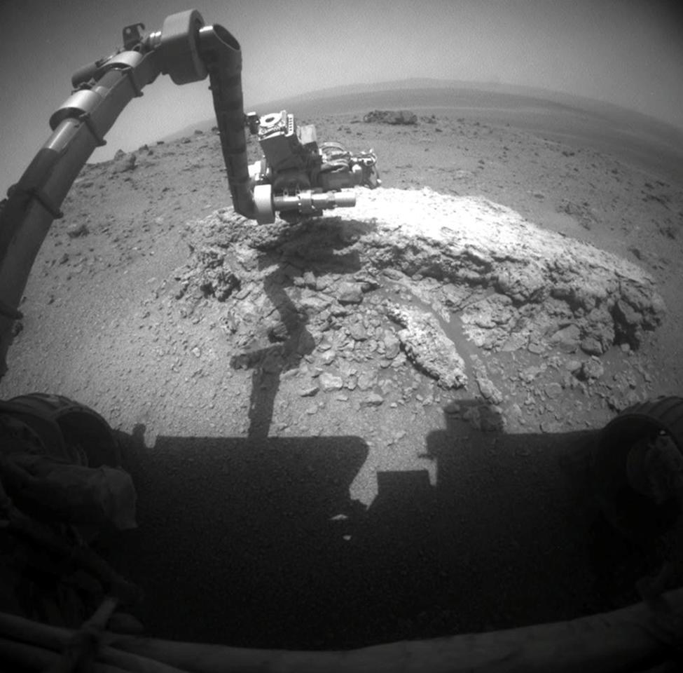 """This image provided Thursday Sept. 1, 2011 by NASA shows NASA's Mars Exploration Rover Opportunity using its camera to take this picture showing the rover's arm extended toward a light-toned rock, """"Tisdale 2,"""" during the 2,695th Martian day, Aug. 23, 2011. The solar-powered rover beamed back images of the horizon, soil and nearby rocks that are unlike any it has seen during its seven years roaming the Martian plains. (AP Photo/NASA)"""