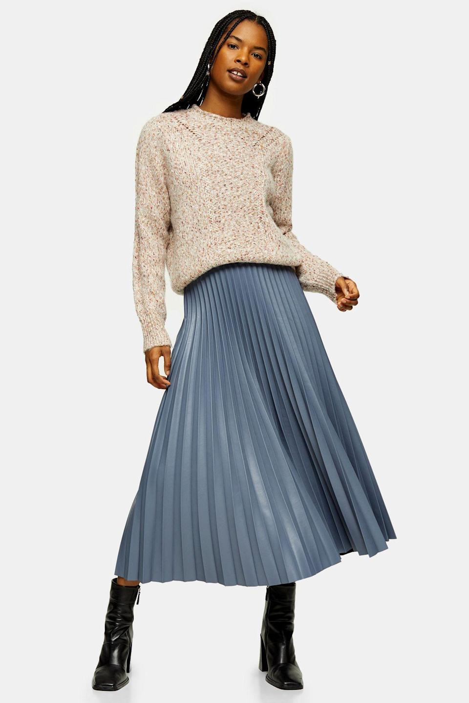 """<p><strong>Topshop</strong></p><p>topshop.com</p><p><strong>$45.00</strong></p><p><a href=""""https://go.redirectingat.com?id=74968X1596630&url=https%3A%2F%2Fus.topshop.com%2Fen%2Ftsus%2Fproduct%2Fslate-grey-pleated-pu-midi-skirt-9520442&sref=https%3A%2F%2Fwww.cosmopolitan.com%2Fstyle-beauty%2Ffashion%2Fg30933395%2Ffall-fashion-trends-2020%2F"""" rel=""""nofollow noopener"""" target=""""_blank"""" data-ylk=""""slk:Shop Now"""" class=""""link rapid-noclick-resp"""">Shop Now</a></p><p>A pleated skirt with a tucked in sweater has fall written all over it. </p>"""